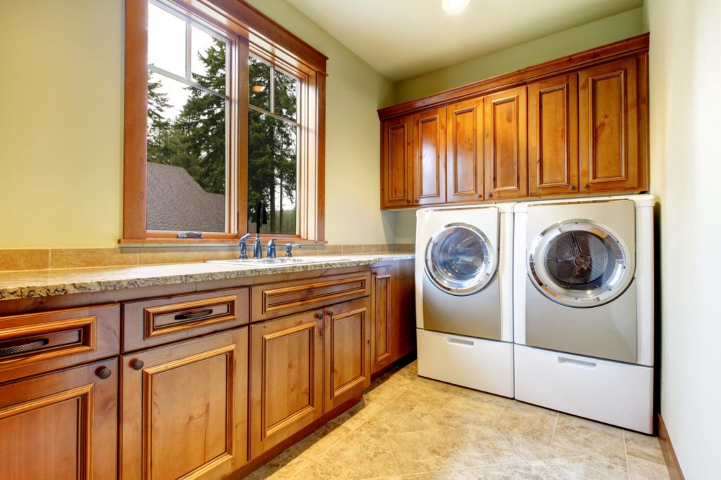 nice looking laundry room cabinets